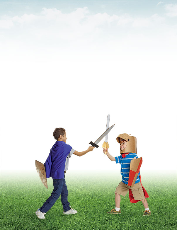 Two kids playing outside with play swords and shields