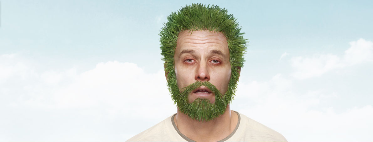 Man suffering from allergies with grass for hair